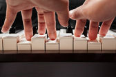 Playing piano from low angle — Stock Photo