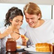 Couple having great time on breakfast — Stock Photo