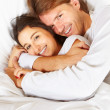 Couple showing romance on bed — Stock Photo
