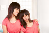 Chinese girl consoling her sad litlle sister who had problem — Stock Photo