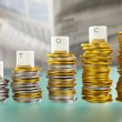 STOCK word on graph like coin stacks — Stock Photo #10807720