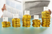 STOCK word on graph like coin stacks — Stock Photo