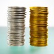 Two stack of silver and gold coins — Stock Photo #10810079
