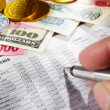 Stock Photo: Observing foreign exchange sheet