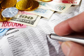 Observing foreign exchange sheet — Stockfoto