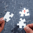 Choosing the right piece of puzzle — Stock Photo