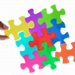 Solving colorful puzzle — Stockfoto