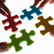 Solving colorful puzzle — Stock Photo