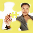 Businesswoman holding the last piece of puzzle — Stock Photo