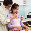 Asian couple activity in kitchen — Stock Photo