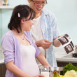 Asian couple looking at USG fetus picture — Stock Photo
