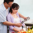 Asian couple looking at USG fetus picture — Stock Photo #10880903