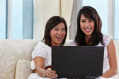 Mother and daughter using laptop — Stock Photo