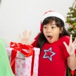 Girl got Christmas ppresent — Stock Photo