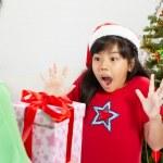 Girl got Christmas ppresent — Stock Photo #10909813