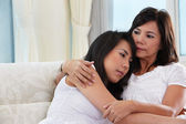 Mother consoling her daughter — Stock Photo