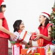 Exchanging present on Christmas — Stock Photo