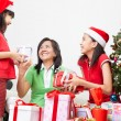 Exchanging present on Christmas - Stock Photo