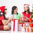 Exchanging present on Christmas — Stock Photo #10991911
