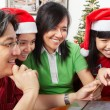 Family doing onlilne shopping for Christmas — Stock Photo #10992043