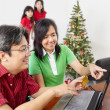 Parents doing online shopping for Christmas — Stock Photo