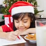 Little girl writing letter to santa — Stock Photo