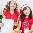 Kids showing blank letter to Santa — Stock Photo #10992406