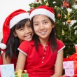Lovely sibling with Christmas outfit — Stock Photo #10992520