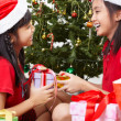 Stock Photo: Exchanging present on Christmas