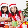 Kids and Christmas present - Stock Photo