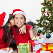 Sibling showing love in Christmas season — Stock Photo #10992805