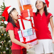 Kids and Christmas present — Stock Photo #10995179
