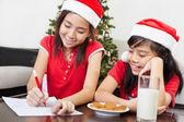 Kids busy preparing letter to Santa — Stock Photo