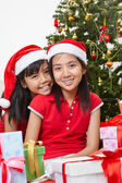 Lovely sibling with Christmas outfit — Stock Photo