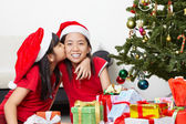 Sibling showing love in Christmas season — Stock Photo