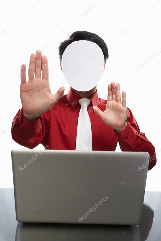 Series of faceless businessman with different gestures in front of his laptop, isolated on white — Stock Photo #10995452