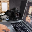 Photographer using laptop — Stock Photo