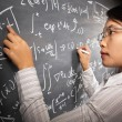 Female student working on equation — Stock Photo #11013943