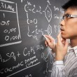 Male student working on equation — Stock Photo #11014026