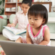 LIttle girl playing laptop — Stock Photo #11015253