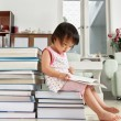 Litlle girl reading lot of books — Stock Photo #11015777