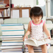 Litlle girl reading lot of books — Stock Photo #11015801