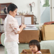Mother and daugher packing — Stock Photo #11016626