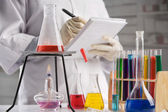 Scientist making notes in laboratory — Stock Photo