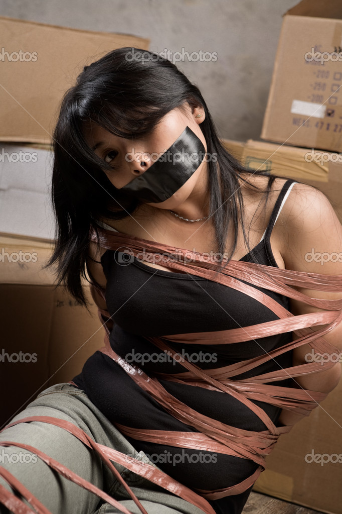 Duct tape mummified girl stands hops - 1 2