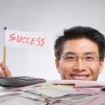 Man holding success flag — Stock Photo