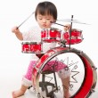 Little girl playing drum — Stock Photo