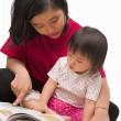 Mother teaching her little girl — Stock Photo