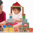 Stock Photo: Mother and child playing together