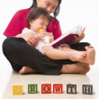 Mother and her little girl reading book — Stock Photo